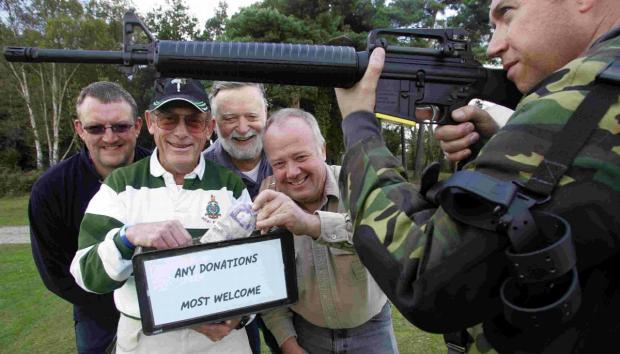 Former Royal Marines Graham Barber and Derek Boorn with club secretary John Seager, club chairman Steven Poultney and Jerry May with his AR15 rifle