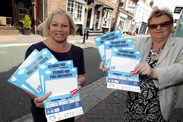 Bournemouth Echo: RETAIL: Poole Council leader councillor Elaine Atkinson, right, and Mandy Payne, president of the Bournemouth Chamber of Trade and Commerce on Poole High Street