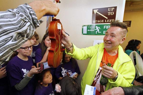 Nigel Kennedy back stage at the Pavilion, Bournemouth, last year meeting the Coda Fiddle Orchestra