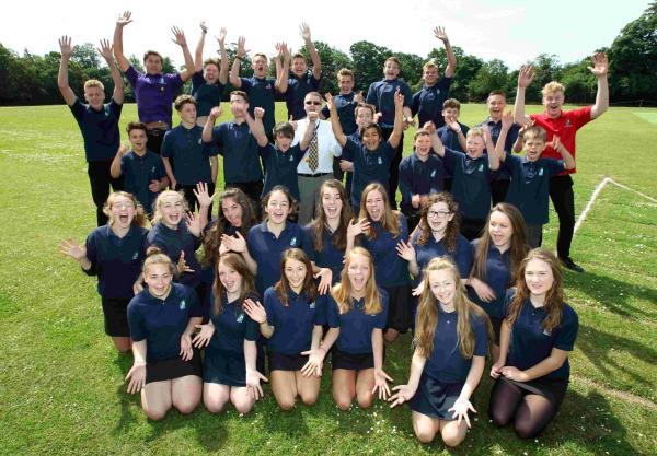 Pupils and headteacher Chris Wilshire, centre, celebrate the investment in the school