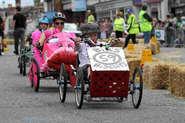 PEDAL POWER: Racers take part in the Pedal Car Grand Prix