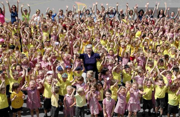 HOORAY: Pupils and staff celebrate the report