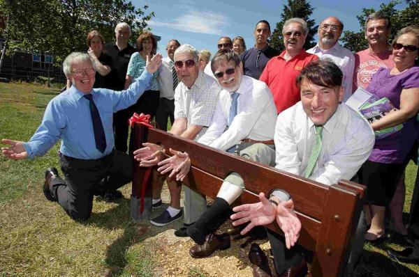 LOCKED STOCK: Deputy mayor, Cllr Dr Rodney Cooper, centre, in the stocks alongside Cllrs Dennis Gritt, left and Amedeo Angiolini, with Rod Haskell, far left and local business representatives