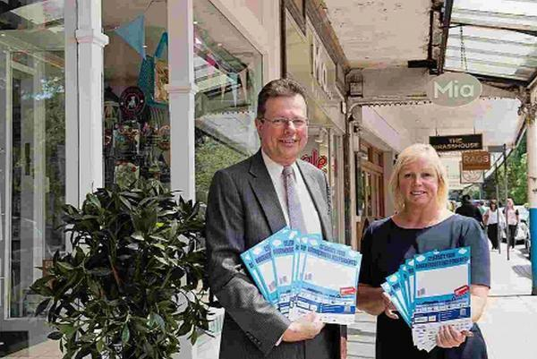 Bournemouth Echo: SHOP LOCAL: John Beesley and Bournemouth Chamber of Trade and Commerce president Mandy Payne supporting Independents Day