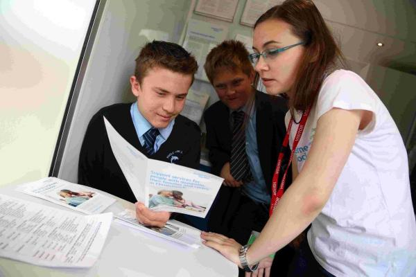 TAKING IT IN: Poole High pupils at the health fair