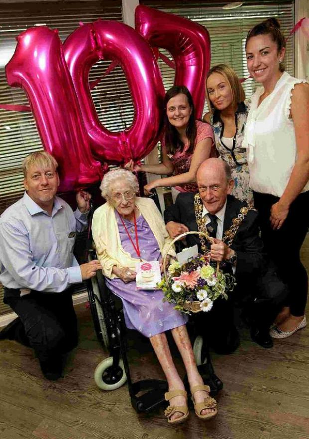 Bournemouth Echo: CELEBRATION: Eve marks her 107th with Mayor Peter Adams and care home staff