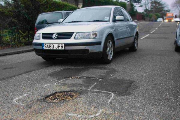 DAMAGED: Motorists are faced with potholes on Upper Road in Parkstone