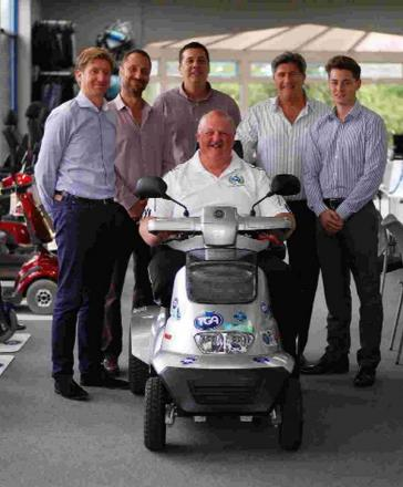 Steve Tarrant presented with scooter he achieved 190-mile challenge on