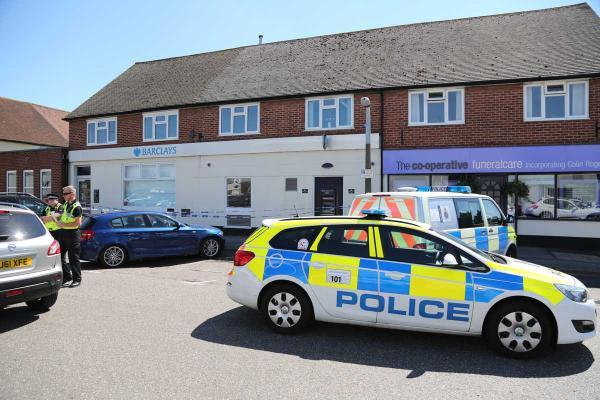 Bournemouth Echo: Police at Barclays bank in Wallisdown
