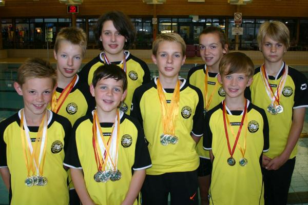 RECORD BREAKERS: (back, l-r) Morgan Hills, Jasmin Oliver-House, Jasmine McCrea, Guy Selwood and (front) Robbie Hemmings, Ryan Openshaw, Chris Parsons and Will Longhurst all broke competition best times