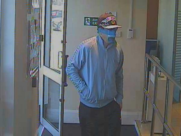 Wallisdown bank robbery: CCTV released of man with blue tape on face