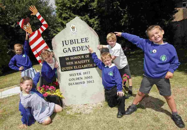 FOUND HIM!: School council representatives from Upton Infant School discover Where's Wally
