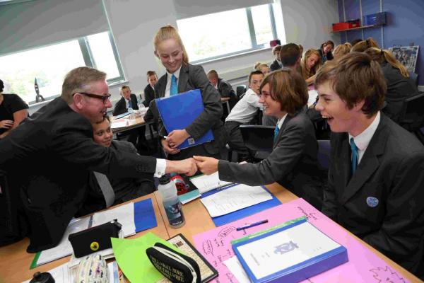 'FANTASTIC': Education Minister Michael Gove MP talks to students at the Swanage School