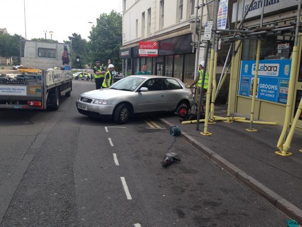 Road closed after car is caught in scaffolding
