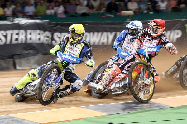 Bournemouth Echo: STRONG SHOW: Darcy Ward (yellow) leads the way in heat one of the British Speedway Grand Prix