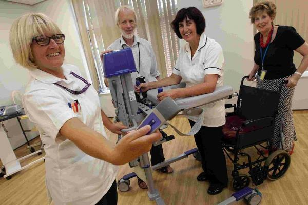 Physiotherapists and Friends of Victoria Hospital show off some of the new equipment. From left Annette Scammell, Peter Cadogan, Sue Cotton and Rae Cotton