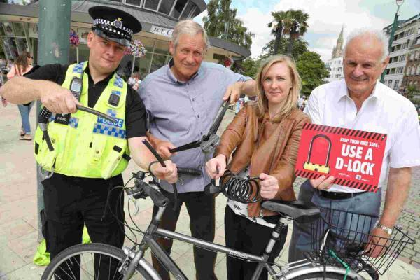 TARGETS: Sgt Dave Moore, Cllr Dave Smith, Rachel Hardy and Cllr Michael Filer in Bournemouth Square to remind cyclists that cable style locks are an easy target for thieves