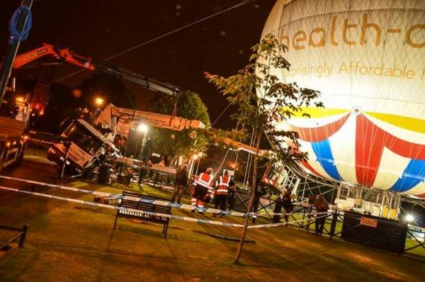 HGV cherry picker topples over - narrowly missing Bournemouth balloon