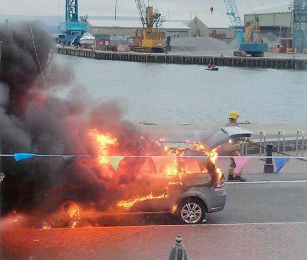 VIDEO: Dramatic moment a taxi burst into flames on Poole Quay