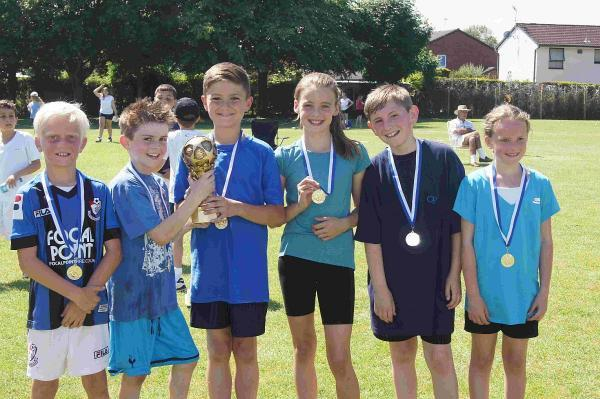 WINNERS: Pupils at Poulner Junior School take part in World Cup Day