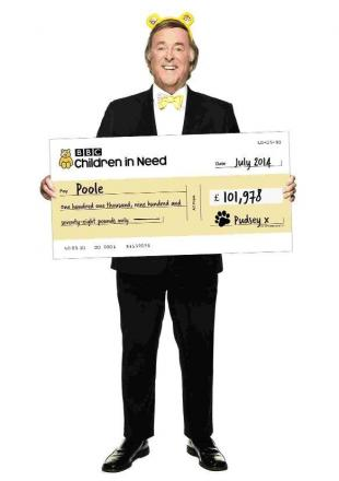 Terry Wogan with the cheque