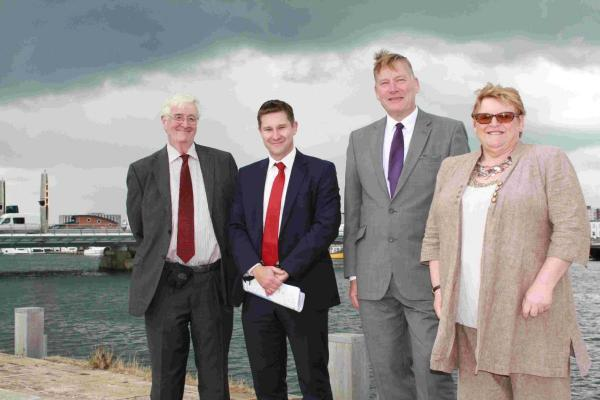 Councillor Mike White, deputy leader of Borough of Poole council, Spencer Claye, Gallagher Associates, Housing Minister Kris Hopkins and Borough of Poole council leader Councillor Elaine Atkinson during a visit to the site of the former power station