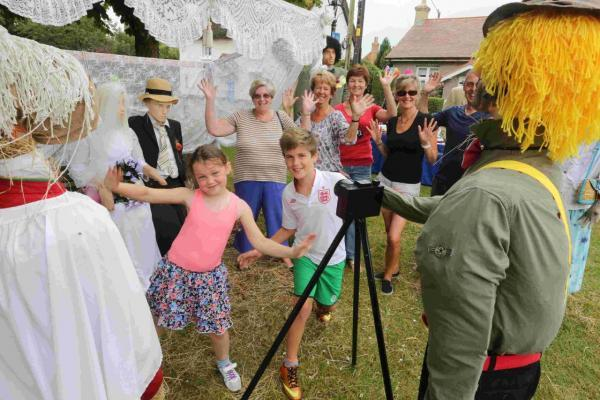 WEDDING JOY: Residents and visitors with the scarecrow wedding at Holdenhurst Village.
