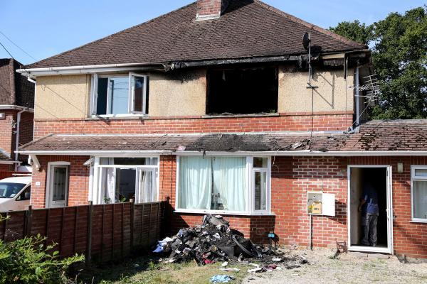 "VIDEO: ""Hero"" neighbour saves family's life as blaze destroys first floor of house"
