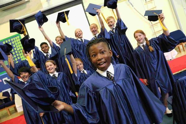 WE DID IT: Queen's Park Academy students celebrate leaving with a graduation ceremony