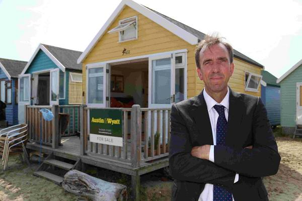 PRICEY: David Bird with the beach hut on Mudeford Sandspit near to Hengistbury Head