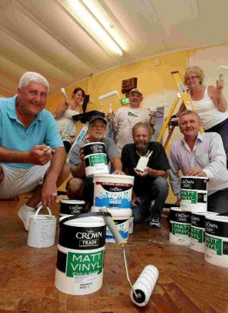 GET YOUR HANDS DIRTY: Volunteers help to re-paint the hall