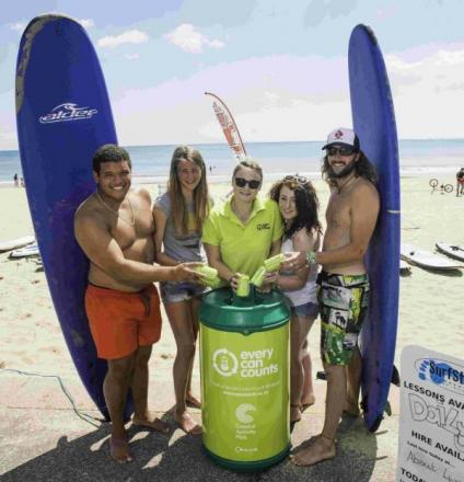 EVERY CAN COUNTS: Beachgoers recycle their drinks cans in the new bins
