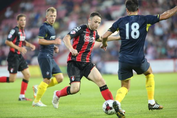 ON THE BALL: Marc Pugh can't find a way past Saints' defence
