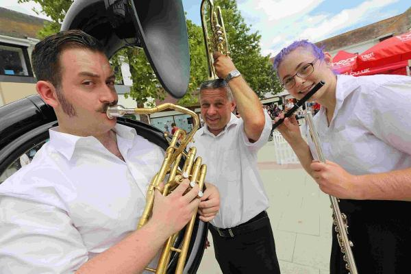 HAVING FUN: James Emmett, Steve Rowland and Katie Stride of the Christchurch and District Band