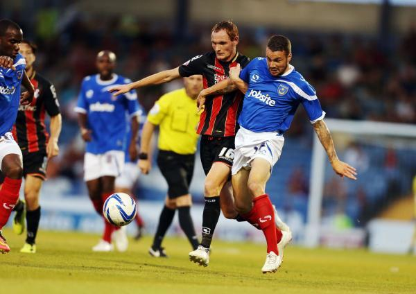 ARMED COMBAT: Shaun MacDonald in a tussle at Portsmouth