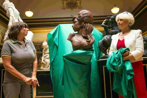 Janis Winehouse, left, unveils Artist Linda Joyce's sculpture of her late daughter Amy Winehouse at the Russell Coates Museum in Bournemouth