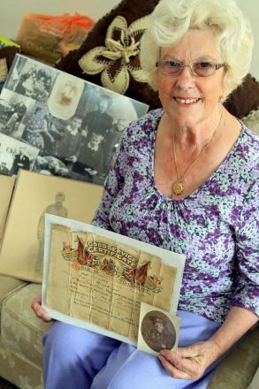 Pat Bryant with some of the records, photographs and memorabilia about her great-uncles and grandfather collection over many years