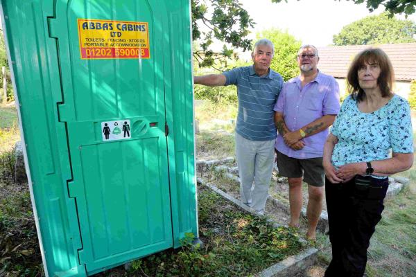 Portaloo left on top of grave by 'callous pranksters'