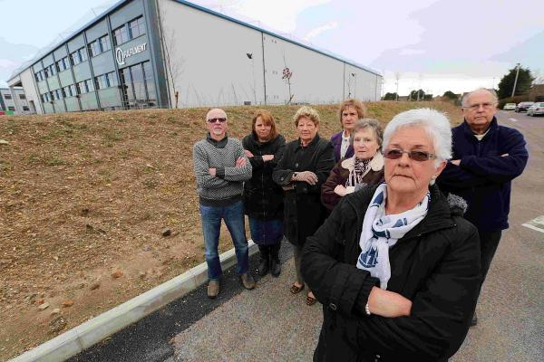 FRUSTRATED: Linda Clarke, chair of the Grange Residents' Association with members beside the warehouse