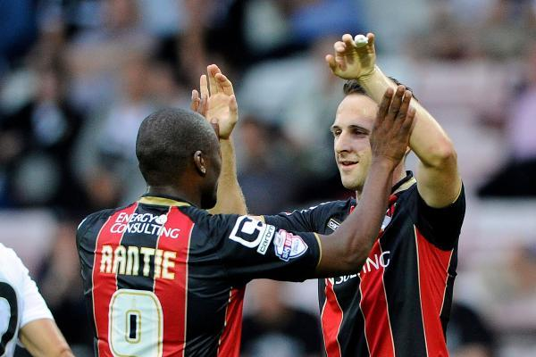 DELIGHT: Marc Pugh celebrates with Tokelo Rantie