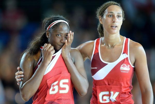 HEARTACHE: England's Geva Mentor (right) consoles team-mate Kadeen Corbin