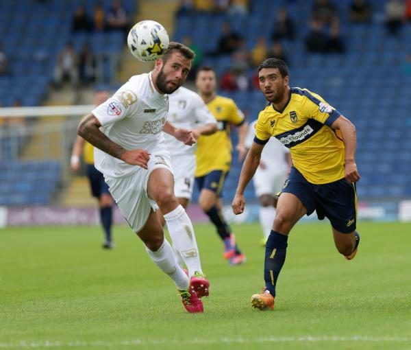 HEADS WE WIN: Steve Cook in action against Oxford United on Saturday