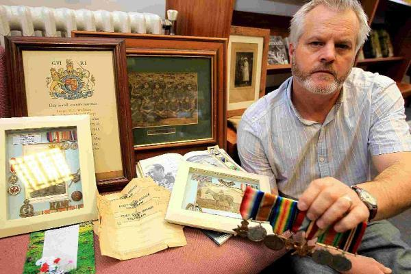 DISTINCTION: Lester Brown with some of his grandad's memorabilia
