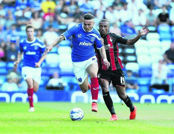 FIRST OUTING: Junior Stanislas (right) at Portsmouth in pre-season