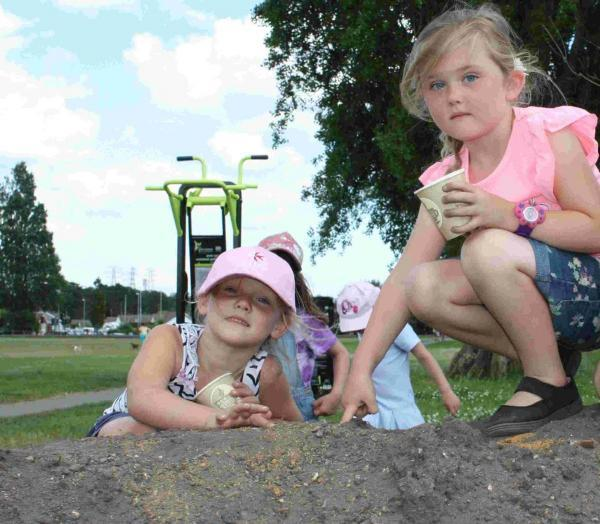 School children in Branksome helped to turn a bare earth mound into a floral bank
