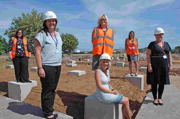BUILDING BLOCKS: From left, teacher Emma Harper, teaching assistant Lucy Burns, Head of Primary Annie Dowling (standing), teaching assistant Amy Hunter (sitting), teacher Christina Gee and receptionist Kirstie Pethers