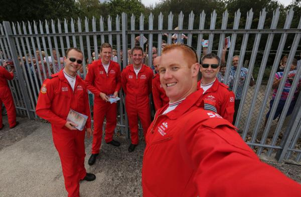UPDATE: Smile if you're in the Red Arrows - team flies into Bournemouth Airport