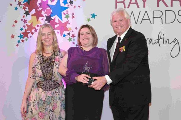 STAR PERFORMER: Sam Birks, manager of McDonald's at Wessex Gate, Poole, receives the Ray Kroc Award for outstanding customer service from Jill McDonald, North West division president and CEO of McDonald's UK, and Doug Goare, president of McDonald's