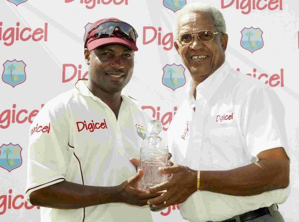 Sir Garfield Sobers (right)