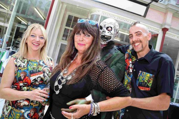 SHOCKING: Actress Caroline Munro, centre, opens Dr Death's Cinema Surgery, with owners Jayne Crimin and Gary Baxter